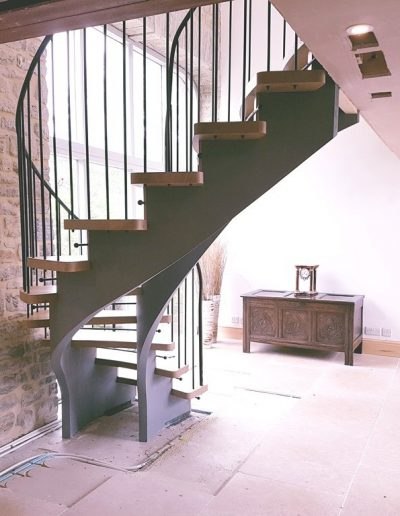 helical-staircase-with-wrought-iron-handrails-2-1024x768